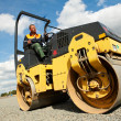Compactor roller at road work - Stock Photo