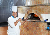 Arab baker chef making Pizza — Stock Photo