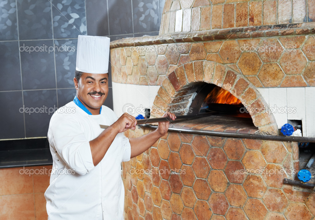 One arab chef baker in white uniform making pizza at kitchen — Stock Photo #6693034