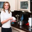 Beautiful happy smiling woman in kitchen interior. — Stock Photo #5395797