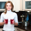 Beautiful smiling woman holding glasses with beverages — Stock Photo
