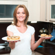 Stock Photo: Beautiful happy smiling womin kitchen interior.