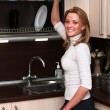 Beautiful happy smiling woman in kitchen interior. — Stock Photo #5395871