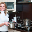 Beautiful happy smiling woman in kitchen interior with casserole — Stock Photo