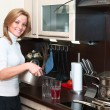 Beautiful happy smiling woman in kitchen interior with casserole — Stock Photo #5395897