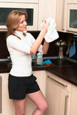 Beautiful happy smiling woman in kitchen interior. One person only — Stock Photo