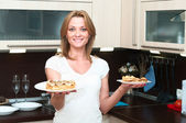 Beautiful happy smiling woman in kitchen interior. — Stock Photo