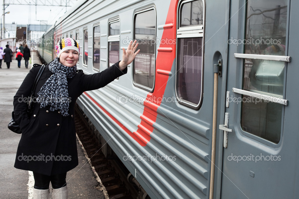 Girl says goodbye departing train and waves by hand after him — Stock Photo #5395872