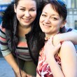Portrait of two young beautiful women a girlfriend — Stock Photo