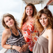 Three beautiful young women a Caucasians standing together on the deck of y — Stock Photo #6375695
