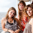 Three beautiful young women a Caucasians standing together on the deck of y — Stock Photo