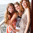 Three beautiful young women a Caucasians standing together on the deck of y — Stock Photo #6375706