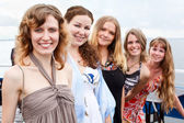 Five young beautiful women are standing in line. Caucasian . Summer time — Stock Photo