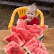 Little child eating watermelon. — Stock fotografie