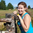 One young Caucasian Russian woman near village fence — Stock Photo #6489811