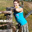 One young Caucasian Russian woman near village fence — Stock Photo #6489816