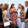 Youth group of eight persons standing together and talking — Stockfoto #6489819