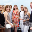 Stockfoto: Youth group of eight persons standing together and looking at camera. C