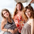 Stock Photo: Three beautiful young women a Caucasians standing together on the deck