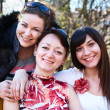 Portrait of three happy friends with a women smiling — Stock Photo