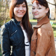 Portrait of two young beautiful women a girlfriend. Standing together. Look — Stock Photo