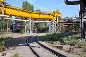 Industrial gas and oil pipelines on metal in a metallurgical plant. Construction area — Stock Photo