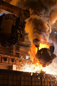 Smelting metal in a metallurgical plant. — Stock Photo