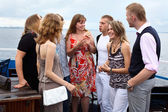 Youth group of eight persons standing together and talking — Stock Photo