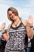 Young caucasian party girl dancing and smiling outdoor — Stock Photo