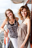 Two beautiful young women a Caucasians standing together on the deck — Stock Photo