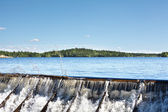 Owerflow of water on the man-made storage pond — Stock Photo
