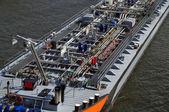 River boat with oil — Zdjęcie stockowe