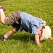 Running boy fall down in park — Stock Photo