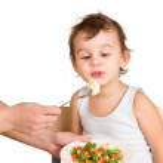 Little boy tasting vegetable salad — Stock Photo #6270305