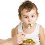 Little boy tasting vegetable salad — Stock Photo #6270332