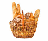 Woven basket with different kind of bread — Stock Photo