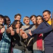 Happy College Students with Thumbs Up — Stock Photo #5413105