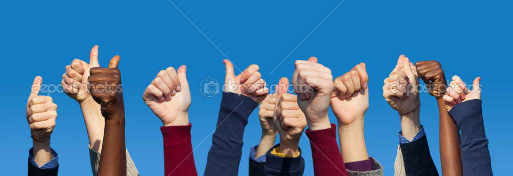 Multiracial Thumbs Up Against Blue Sky — Stock Photo #5475778