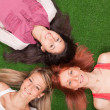 Young Girls Lying on the Ground — Stock Photo #5643890