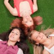 Royalty-Free Stock Photo: Young Girls Lying on the Ground