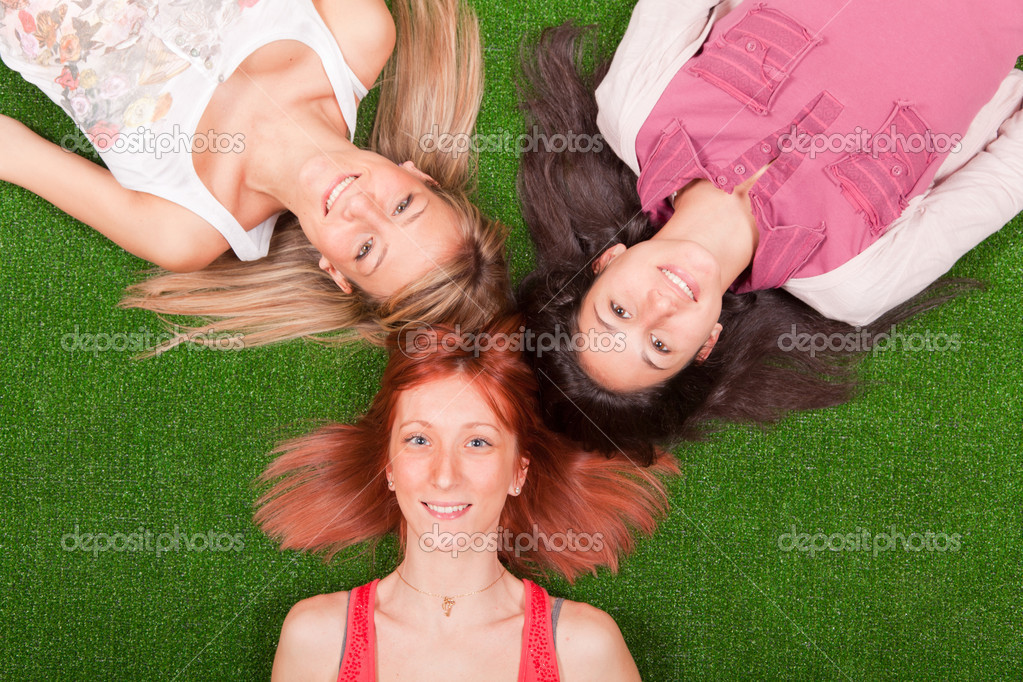 Young Girls Lying on the Ground — Stock Photo #5643892