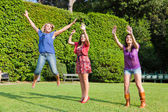 Happy Teenage Female Friends Jumping — Stock Photo
