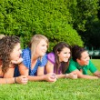 Teenage Female Friends Lying on Green at Park — Stock Photo #5767225