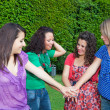Teenage Female Friends with Hand in Stack — Stock Photo #5851228