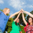Teenage Female Friends with Hand in Stack — Stock Photo #5851230