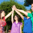 Teenage Female Friends with Hand in Stack — Stockfoto #5851232