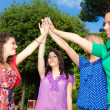 Stok fotoğraf: Teenage Female Friends with Hand in Stack