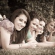 Teenage Female Friends Lying on Green at Park — Stock Photo #5851235