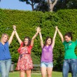 Happy Teenage Girls with Outstretched Arms — Stock Photo #5851238