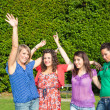Happy Teenage Girls with Outstretched Arms — Stock Photo #5851240